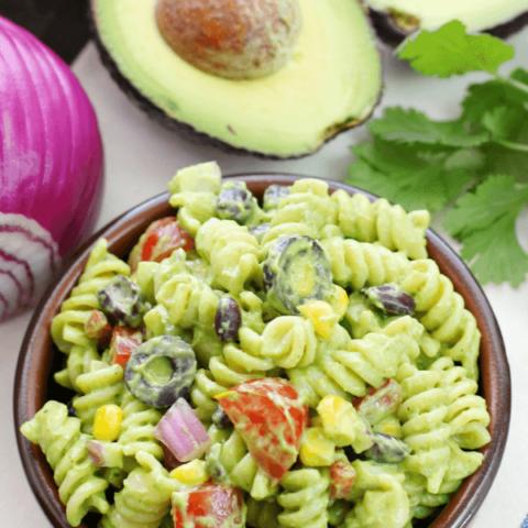 Avocado-Cilantro Pasta Salad in a brown bowl.
