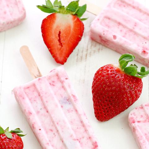 Strawberry-Yogurt Popsicles with fresh strawberries.