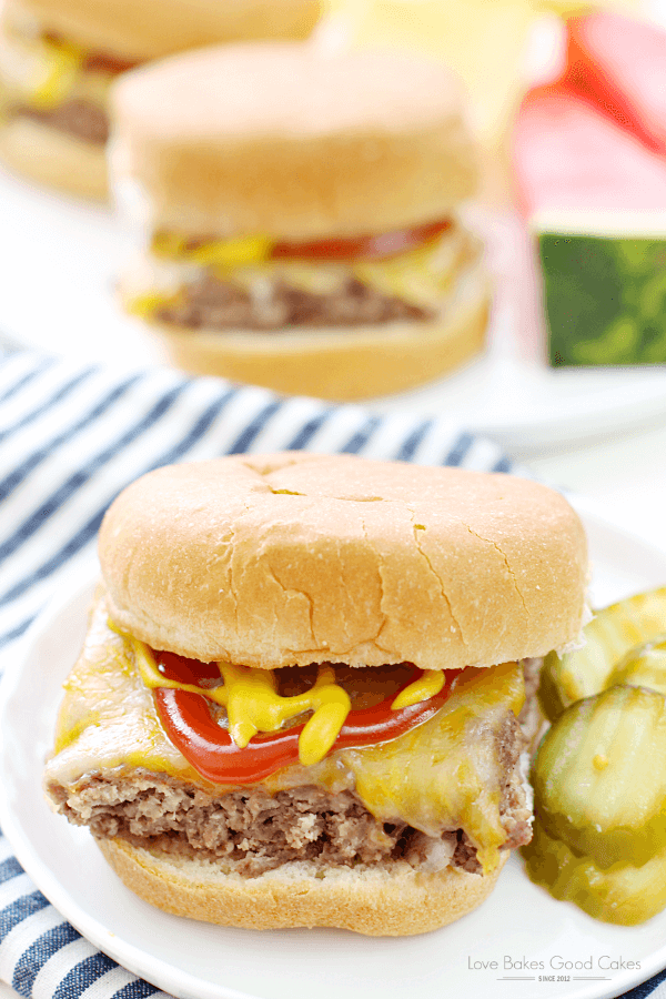Easy Beef Slider on a white plate with sliced pickles.