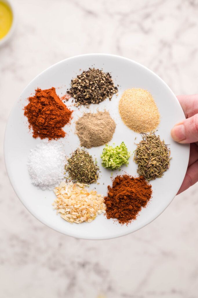 spices and herbs on plate to make Blackened Seasoning