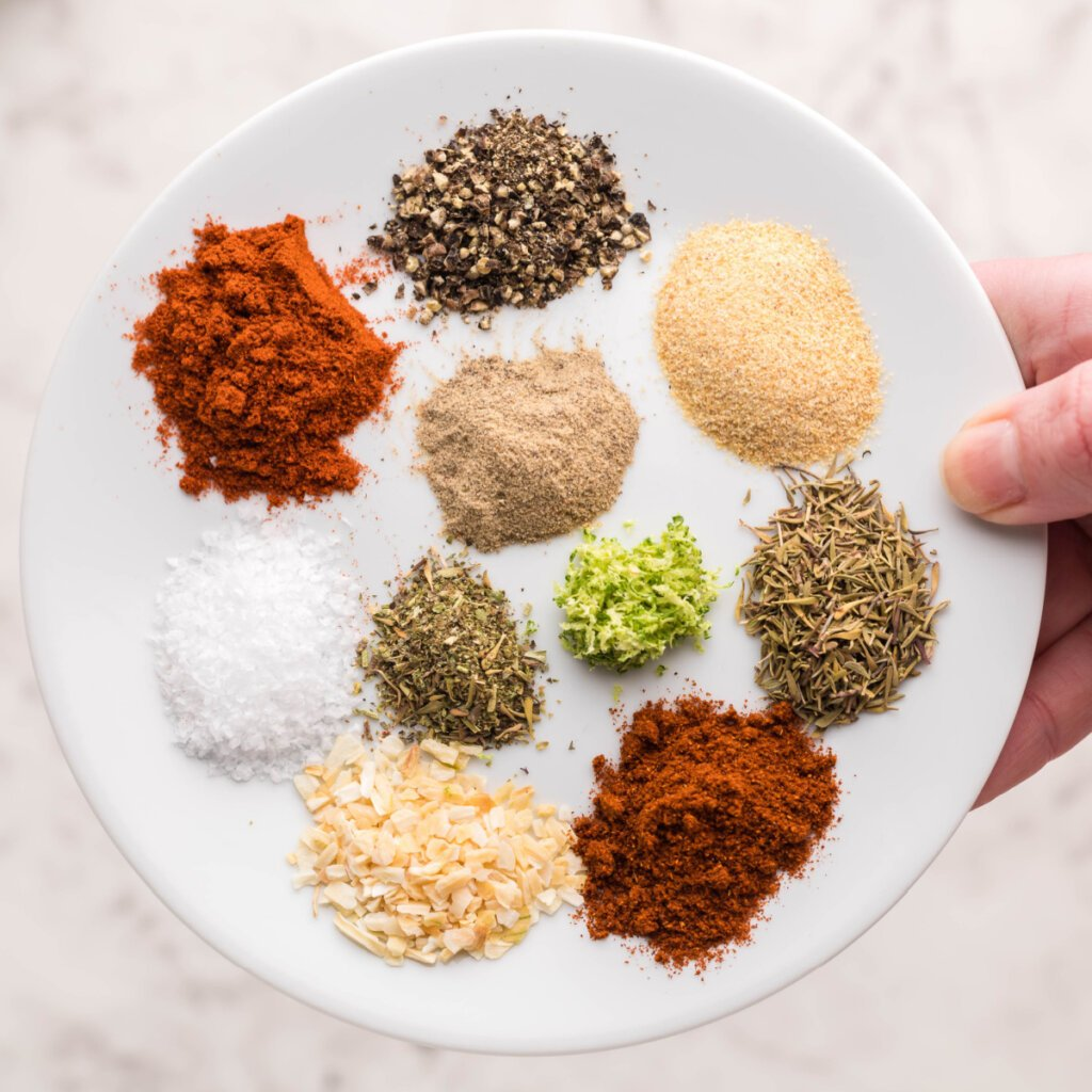 plate with assorted spices and herbs