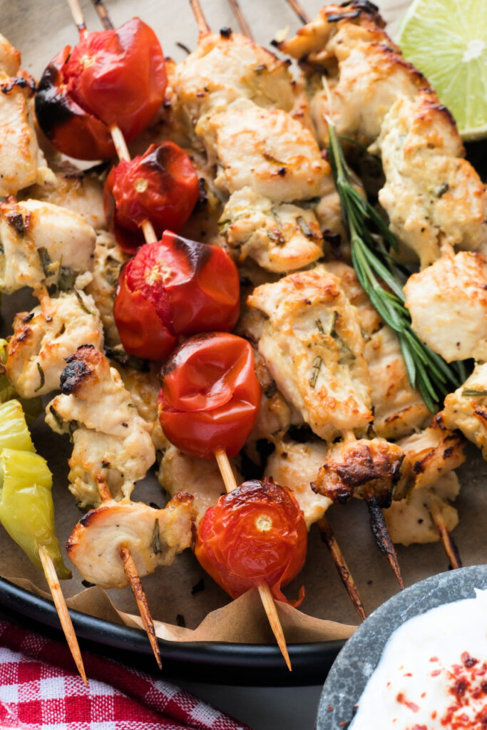 chicken skewers stacked on serving tray