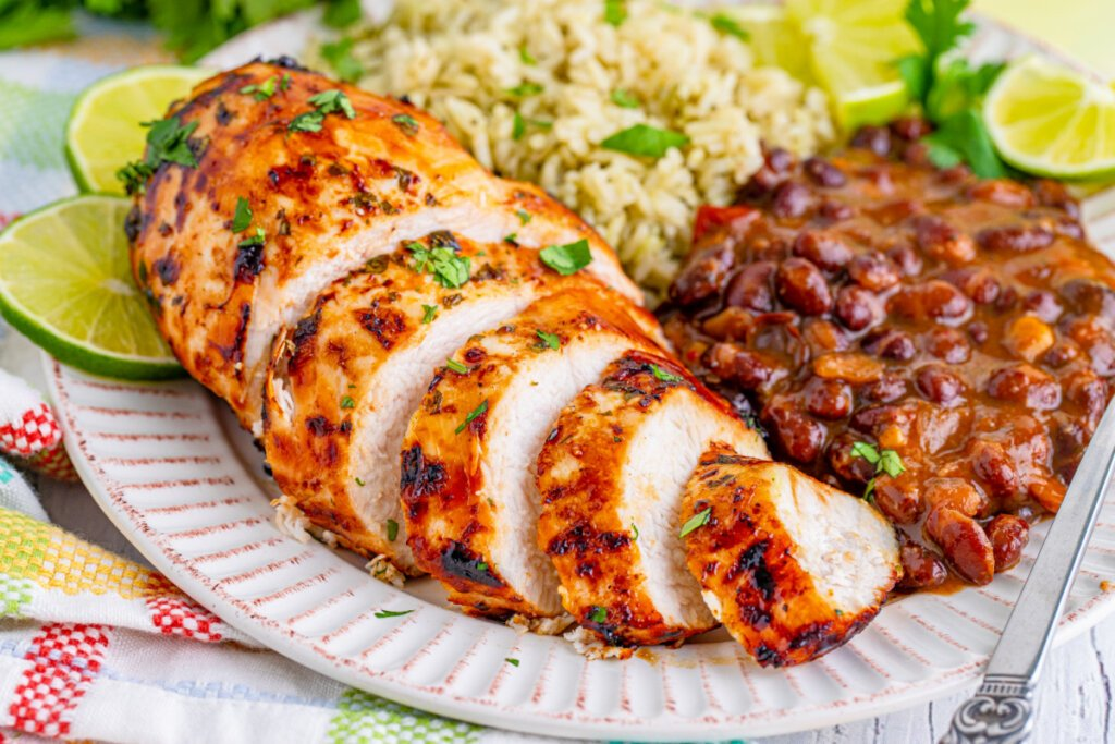 cooked meat plated with rice and beans