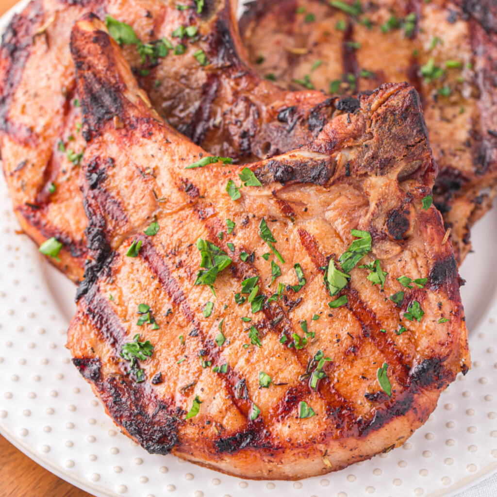 closeup of grilled pork chops on plate