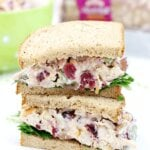 Lighter Chicken Salad Sandwiches stacked on a white plate.