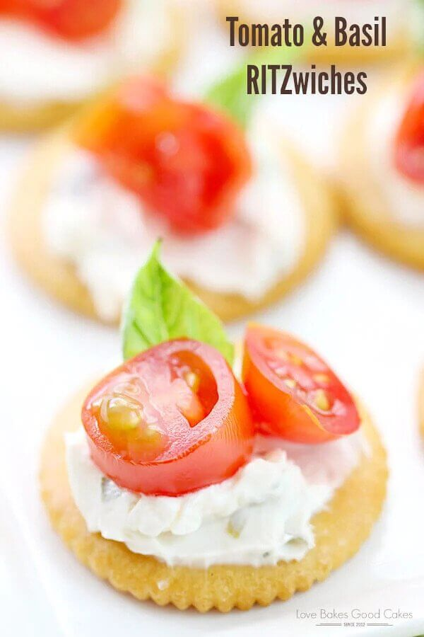 Ritz crackers with tomatoes and basil.