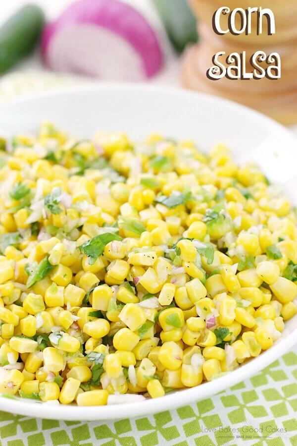 Corn with diced onions in a white bowl.
