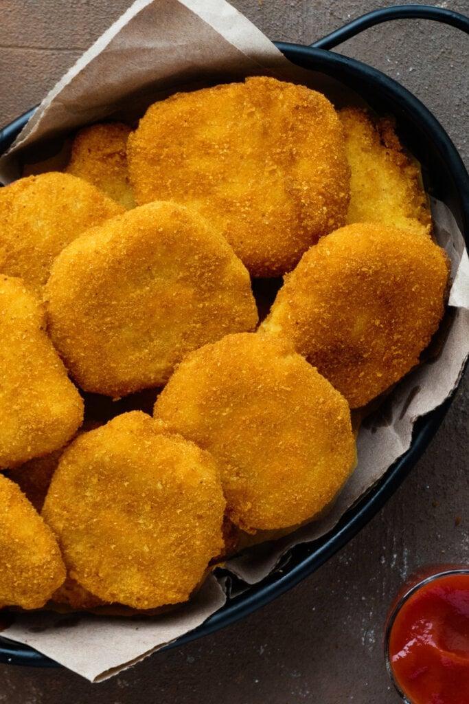 black metal basket filled with chicken nuggets