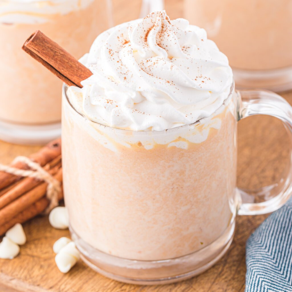 cup of pumpkin spice white hot chocolate with whipped topping on top