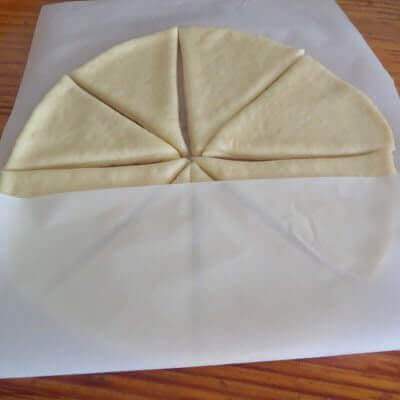 Lay parchment paper over the cut slices.
