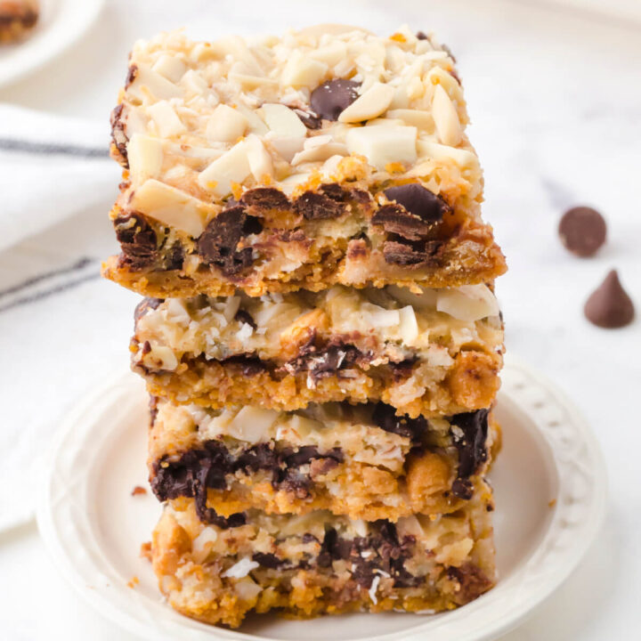 magic cookie bars on white plate