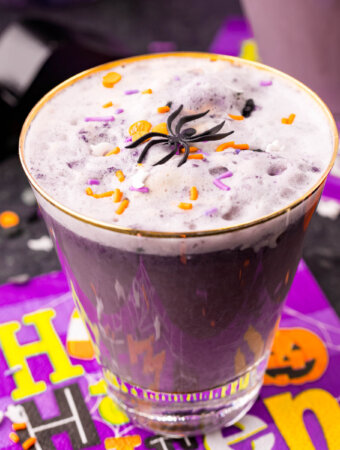 glass of purple witch's brew punch